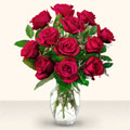 Karşıyaka çiçek gönderme sitemiz güvenlidir  10 adet gül cam yada mika vazo da