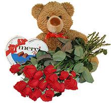 oyuncak çikolata  12  gül   Karşıyaka çiçek gönderme sitemiz güvenlidir